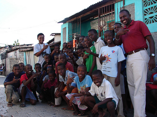 Pax Christi Port-au-Prince staff with kids