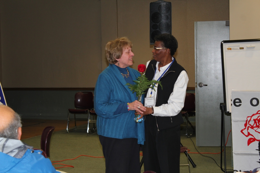 Pax Christi Michigan State Coordinator embraces PCUSA Executive Director Sr. Patty Chappell, SNDdeN, at the Michigan regional dialogue in February. (Photo courtesy of PC-Michigan).