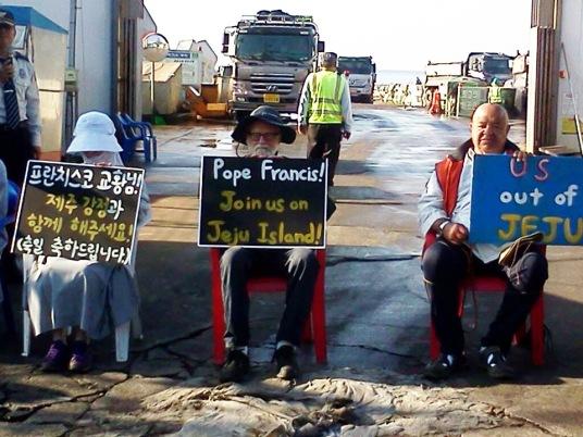 PC Pacific Northwest icon Fr. Bill Bichsel protests at Jeju Island.