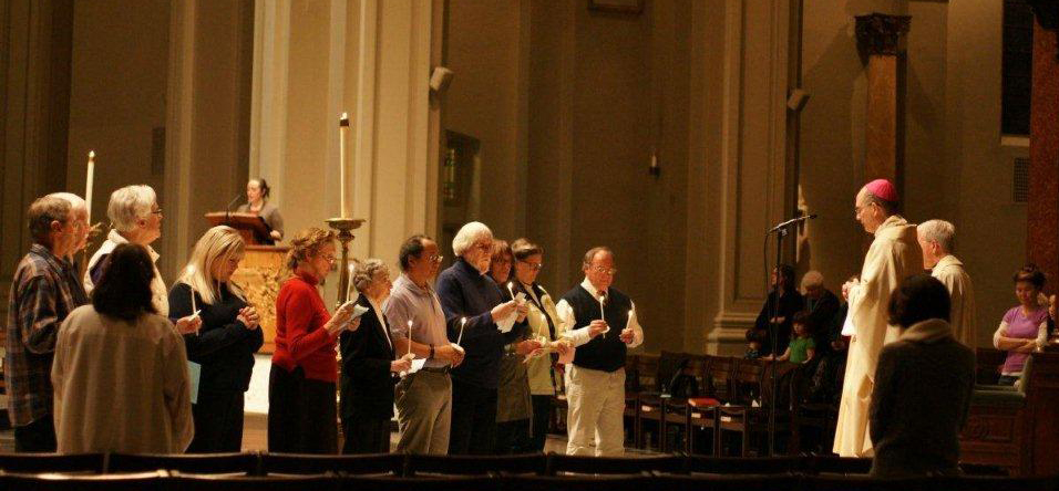 Members of Pax Christi in Seattle take the Vow of Nonviolence with Archbishop Sartain on MLK Day. (Photo by Maria Laughlin)