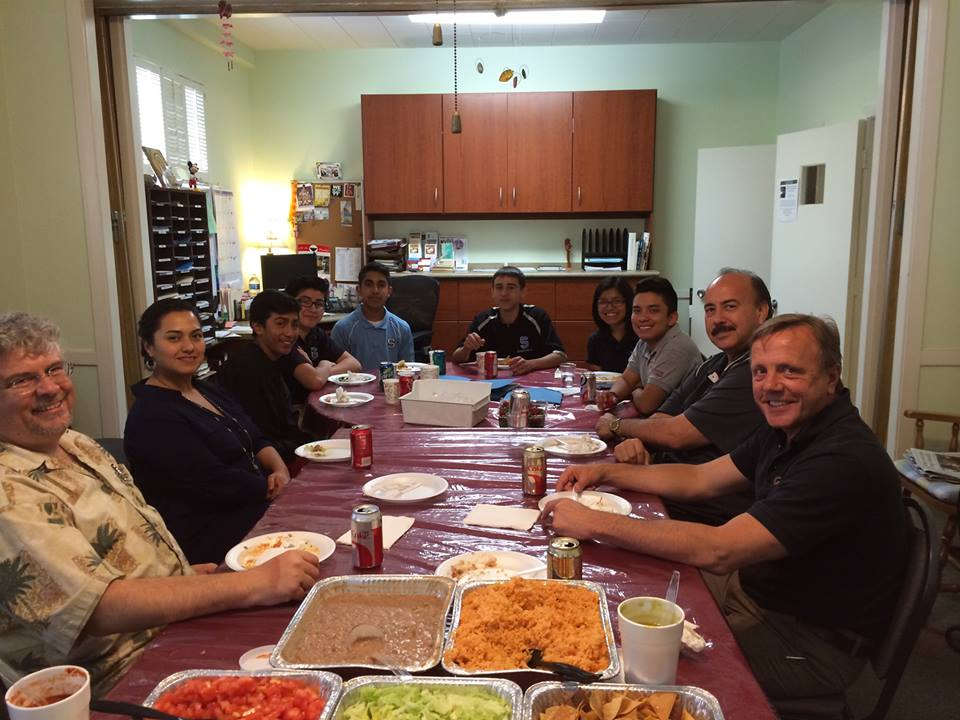 Pax Christi Los Angeles leadership share lunch with area directors of campus ministry and student leaders.