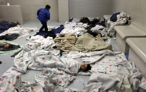 Child detainees sleep in a holding cell at a US Customs and Border Protection processing facility in Brownsville, Texas.