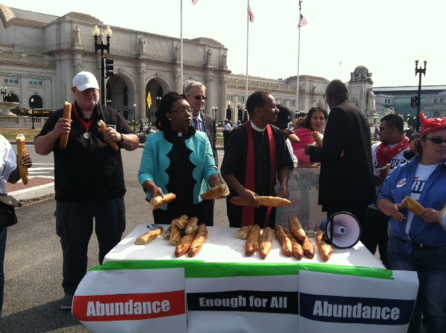 """PCUSA Ambassador of Peace Joseph Fahey (far left) participates in a """"breaking bread"""" civil disobedience action in support of striking workers in D.C. (photo by Jean Stokan)"""