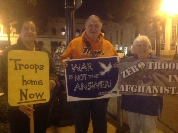 Pax Christi Orange County members Alice Soto, Lucille Martin and Mike Walsh at the monthly Orange County Peace Coalition vigil at the Orange Circle in Orange, CA,