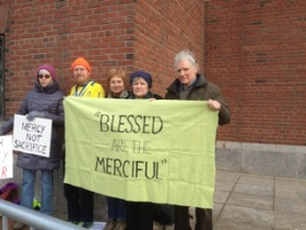 first vigil at the Moakley courthouse in Boston. The people: Katie Flaherty, Scott Schaeffer-Duffy from the SS Francis and Therese Catholic Worker in Worcester, MA, me, Suzanne and Brayton Shanley of the Agape Community.