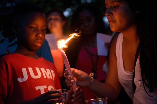 People participate in a candlelight vigil at Marion Square near the Emanuel AME Church in Charleston, South Carolina(Brendan Smialowski/AFP)