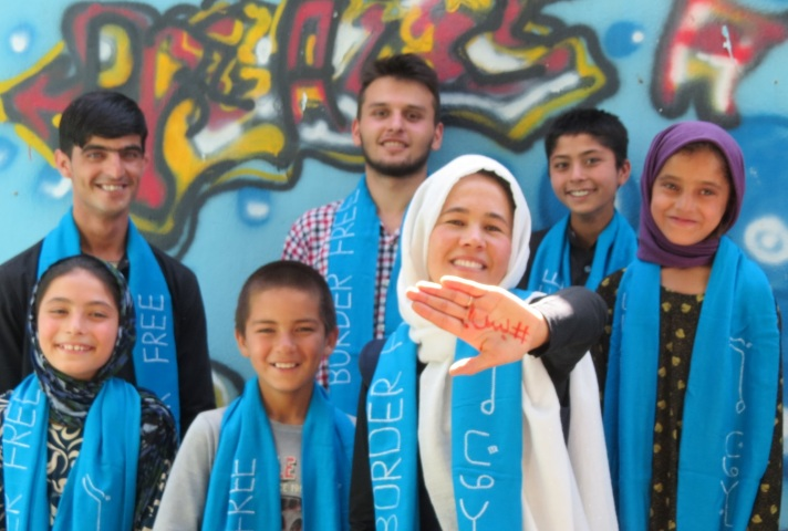 Zarghuna with the word #Enough! in Dari/Pashto on her hand, with her friends from the Afghan Peace Volunteers and Borderfree Street Kids ( from left to right : Mursal, Barath, Inam, Muheb, Zarghuna, Kahar and Zahra)