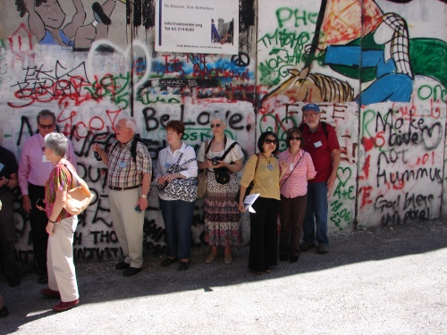 Rosemarie Pace, PC Metro NY coordinator (center) at the Separation Wall in Bethlehem.