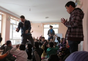 Children at the Afghan Peace Volunteer's Borderfree Street Kid's School learn from Ellis Brooks and Dr. Hakim about resolving conflicts peacefully. (By Dr. Hakim)