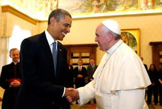 U.S. President Barack Obama shakes hands with Pope Francis (R) during their meeting at the Vatican March 27, 2014.
