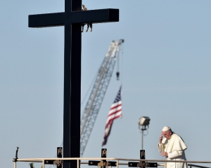 Pope Francis prays at the U.S.-Mexico border.