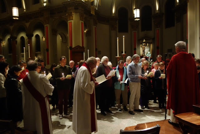 Pax Christi Seattle members take the Vow of Nonviolence at St. James Cathedral on the Feast of the Holy Innocents.