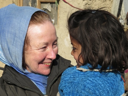 Kathy Kelly and Shoba at Chamin e Babrak refugee camp in Kabul. Shoba had been saved from a fire just days earlier. Photo credit Abdulhai Darya